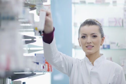 Young female pharmacist standing in a pharmacy