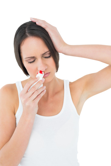Woman in White Shirt having a Nose Bleed