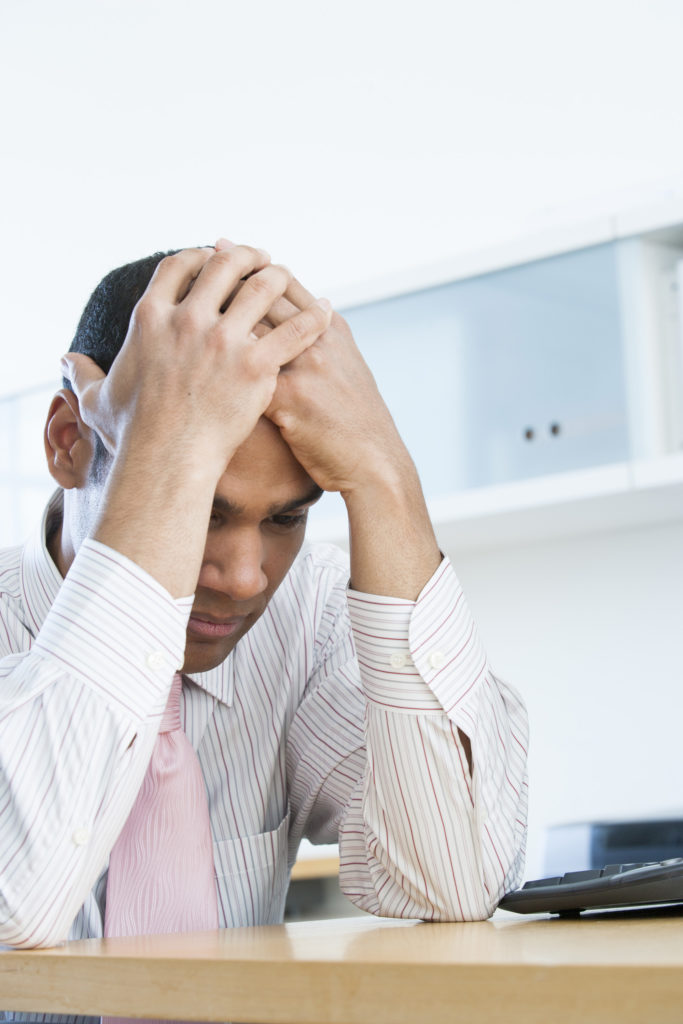 Businessman Experiencing Symptoms of Stress